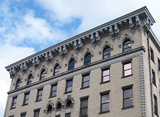 Cornice - An example of a cornice, above large corbels, along the top of the Wheeling-Pittsburgh Steel Building in downtown Wheeling, West Virginia, United States.