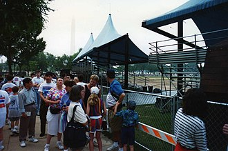 White House Visitors Office - The line to get same-day tour tickets stretched a long way around in June 1994, with the Washington Monument looming in the early morning distance.