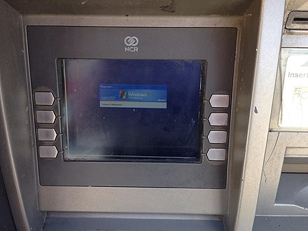 Although the operating system has been off support by Microsoft for over four years as of August 2018, a significant number of cash points still use versions of Windows XP, as seen with this machine at a branch of Tesco Express in Slough, Berkshire. Windows XP sighted 'in the wild' on a cash point, 3 August 2018.jpg
