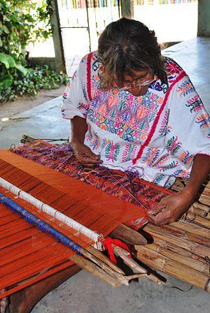 Handcrafts of Guerrero - Amuzgo weaver working on a backstrap loom in Xochistlahuaca