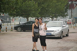 English: Two Chinese woman posing for the camera.