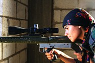 Ypj-fighter-aiming-firearm.jpg
