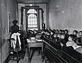 """""""A Class in the Condemned Essex Market School, With the Gas Burning by Day"""" (5389944638).jpg"""