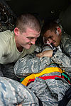 1-228th Aviation Regiment and 612th Air Base Squadron work together during crash rescue training 150115-F-ZT243-076.jpg