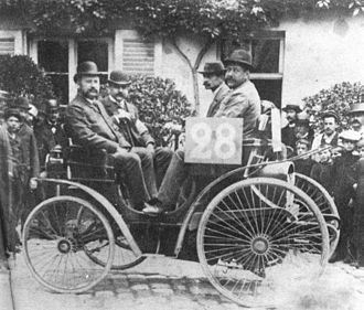 Auguste Doriot - Auguste Doriot (second from right) driving a Vis a vis (Face to face) Peugeot 3hp during the 1894 Paris-Rouen Contest