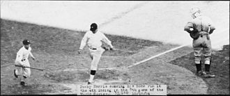 Minnesota Twins - Washington's Bucky Harris scores on his home run in the fourth inning of Game 7 of the 1924 World Series.