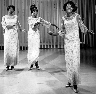 Diana Ross - Diana Ross (far right) performing with the Supremes as lead singer