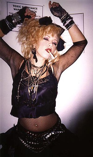 Impersonator - A Madonna wannabe, an impersonator of Madonna's 1980s looks and fashion style.