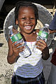 2-319th, Black Falcons, Deliver Much Needed Food and Water in Port-au-Prince DVIDS246886.jpg