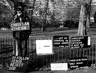 "Christian atheism - A man promoting Christian atheism at Speakers' Corner, London, in 2005. One of his placards reads: ""To follow Jesus, reject God""."