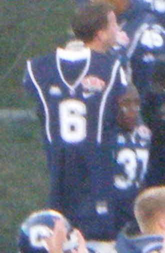 2010 PapaJohns.com Bowl - Jersey of Jasper Howard, held aloft