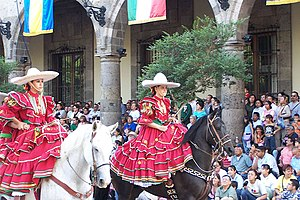 Charreada - Charras in parade wearing the traditional Adelita.