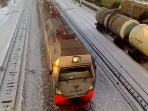 Файл:2ES10-003 with freight train from above.webm
