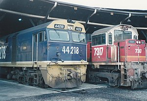 State Rail Authority - 44218 in FreightCorp livery alongside 7317 in the candy livery at Broadmeadow Locomotive Depot circa 1990