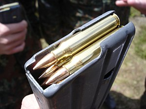 5.56×45mm NATO - 5.56×45mm NATO cartridges in a STANAG magazine.