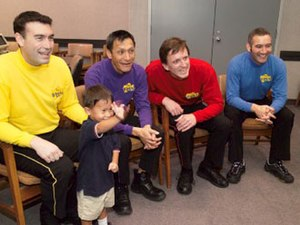 The Wiggles - Four of the original Wiggles (and a fan) in 2004 (seated from left to right: Greg Page, Jeff Fatt, Murray Cook, and Anthony Field)