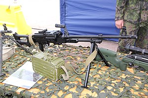 PK machine gun - PKM general-purpose machine gun with modern black polymer furniture and a 100-round ammunition box