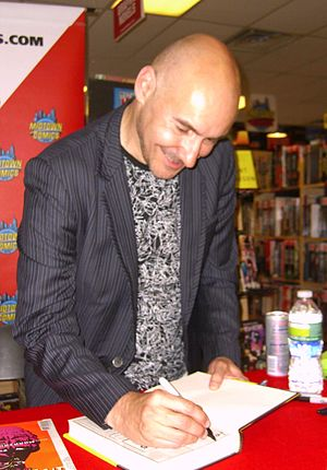 Grant Morrison - Morrison signing copies of his 2011 superhero analysis, Supergods, at Midtown Comics in Manhattan, 19 July 2011.