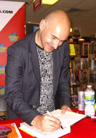 Grant Morrison - Morrison signing copies of his 2011 superhero analysis, Supergods, at Midtown Comics in Manhattan, 19 July 2011