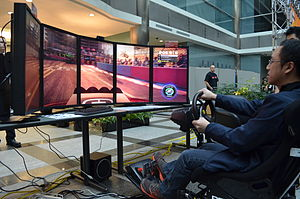 AMD Eyefinity - Playing a racing video game on Single Large Surface (SLS) with a 5x1 portrait display group configuration at ExtravaLANza 2012 in Toronto.