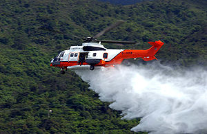 Rotorcraft - An AS332 helicopter from the Hong Kong Government Flying Service conducts a water bomb demonstration