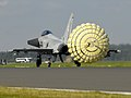 A Typhoon F2 fighter jet deploys a brake parachute as it lands at RAF Coningsby MOD 45147966.jpg