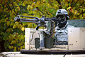A U.S. Soldier assigned to Alpha Troop, 1st Squadron, 91st Cavalry Regiment, 173rd Infantry Brigade Combat Team scans the terrain from the turret of a Humvee during reconnaissance training at the Joint 131016-A-HE359-005.jpg