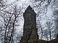 A view of the Wallace Monument from the surrounding Forest.jpg