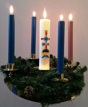 Midnight Mass - On Christmas Eve, the Advent Wreath is traditionally completed with the lighting of the Christ Candle in many church services.