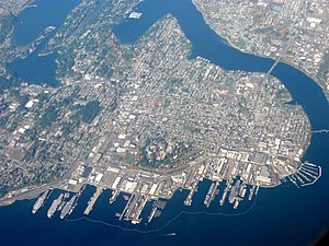 Bremerton, Washington - Aerial view of the city with Puget Sound Naval Shipyard at the bottom