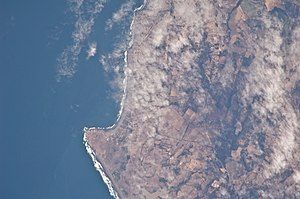 Pichilemu - Aerial view of Pichilemu. The urban area is located at the top, while Punta de Lobos can be seen at the bottom.
