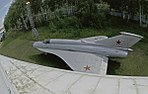 Aircraft Mig-21I under the wing of the plane Tu-144 (9678535680).jpg