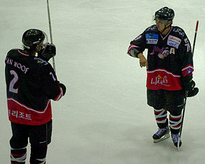 High1 - Alex Kim discusses strategy on-ice with Jeremy van Hoof. Kim won two points titles his first year in the league.