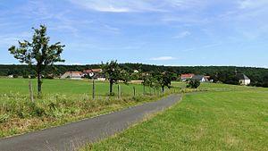 Bad Soden-Salmünster - The Stadtteil of Alsberg, a hill village (Höhendorf) from the northwest; the Wallfahrtskirche Heilig Kreuz on the right