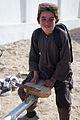 An Afghan boy plays on a teeter-totter in Ananzai village, Kandahar province, Afghanistan, Dec. 26, 2011 111226-A-VB845-243.jpg