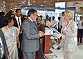 Anand Sharma interacting with a foreign delegate, at the 19th Indian International Seafood Show 2014, in Chennai. The Minister for Labour & Employment, Fisheries, Rural Development, Goa.jpg