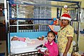 Anya Dillard giving out gift bags at her first holiday gift drive in 2009.jpg