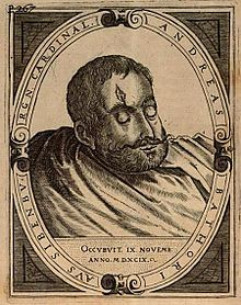 A head of a bearded man with a wound on his forehead