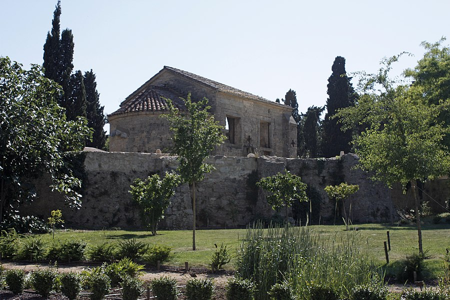 """English:  The orchard, just before the enclosure of the garden. In the background the ruins of the ancient chapel """"San Joan dos Annels""""."""