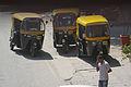 Bangalore Autorickshaws and guy on phone November 2011 -2-4.jpg