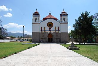 San Bartolo Coyotepec - The Church of San Bartolo, with ancient Zapotec civilization Pyramids in the left background.