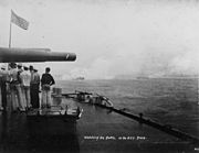 picture of large guns of USS Iowa with smoke coming out