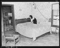 Bedroom home of Alvis New, miner who lives in company housing project. Adams, Rowe & Norman Inc., Porter Mine... - NARA - 540593.tif