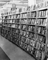 Books and magazines for sale at Clark's, a grocery, drug, sundries, and department store and lunch counter, 3900 North Independence Boulevard, Charlotte, NC, c.1962 or 1963. From the General Negative (6876069203).jpg