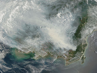 Deforestation in Indonesia - NASA's Terra satellite picture of thick smoke hung over the island of Borneo on 5 October 2006. The fires occur annually in the dry season (August–October), caused mainly by land-clearing and other agricultural fires, but fires escape control and burn into forests and peat-swamp areas.