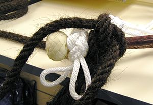 Mecate rein - Detail of a horsehair mecate tied next to a fiador on a bosal