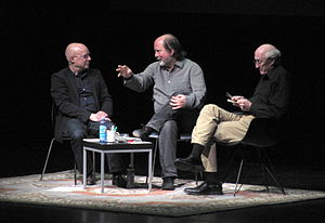 "Long Now Foundation - Brian Eno, Danny Hillis, and Stewart Brand speaking at ""The Long Now, now"" – an event in January 2014 at the Palace of Fine Arts in San Francisco."