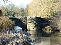 Bridge over moat at Holford Hall.jpg