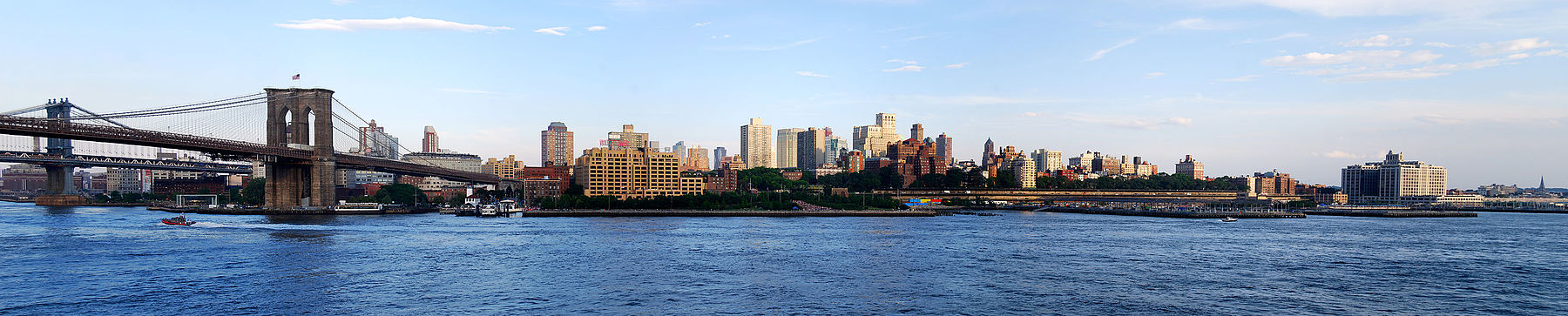 The Downtown Brooklyn skyline at the western end of Long Island. The Manhattan Bridge (far left) and the Brooklyn Bridge (near left) are seen across the East River from Lower Manhattan at sunset in June 2013.