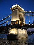 Budapest chain bridge pillar by night.JPG